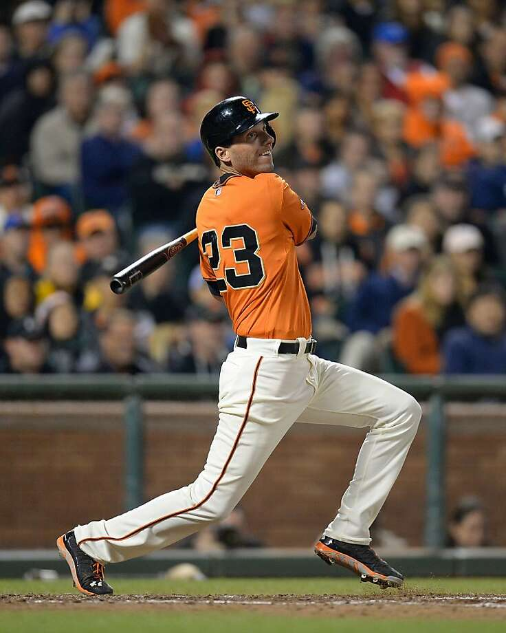 Jeff Francoeur hits a bases-loaded single in the seventh to knock in both of the Giants' runs. Photo: Thearon W. Henderson, Getty Images