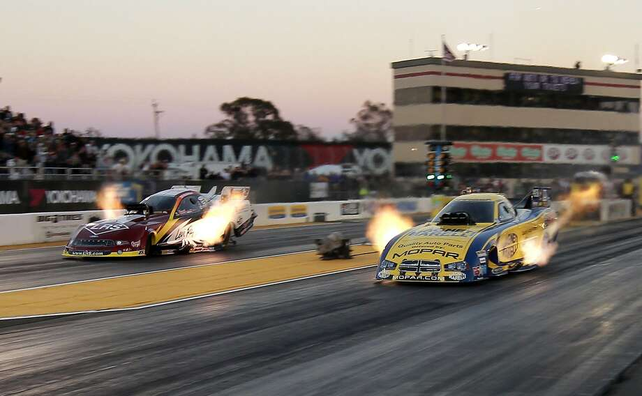 Matt Haggan (right, at Sonoma in 2012) won his second Funny Car championship last year and has four wins this year. Photo: Michael Macor, San Francisco Chronicle