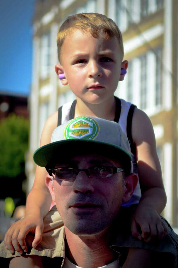 Leo Battleship Leonard rides on his father, Jeff, shoulders as they watch Deadkill at the Vera Project Stage at the Capitol Hill Block Party Friday, July 26, 2013, in Seattle. Photo: SY BEAN, SEATTLEPI.COM / SEATTLEPI.COM