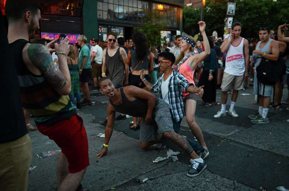 Concertgoers dance in the street during the 2013 Capitol Hill Block Party Friday, July 26, 2013, in Seattle. Photo: SY BEAN, SEATTLEPI.COM / SEATTLEPI.COM