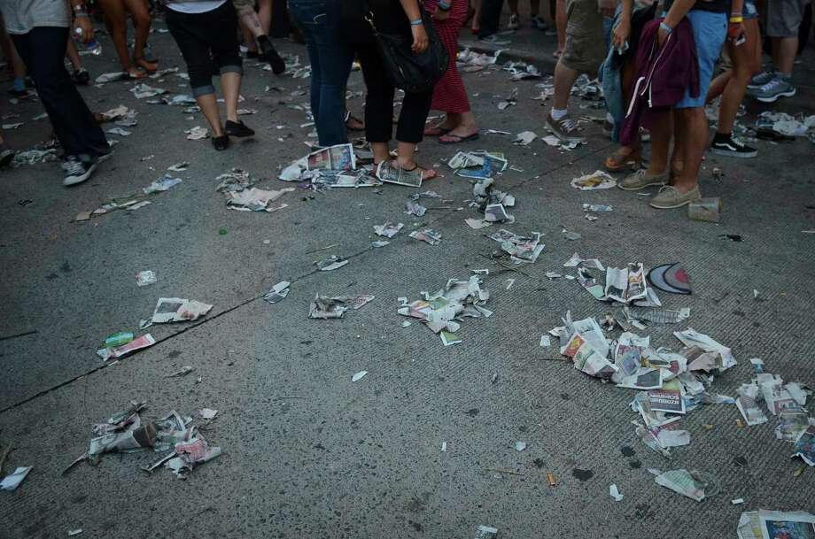 Shredded Capitol Hill Block Party guidebooks litter the ground Friday, July 26, 2013, in Seattle. Photo: SY BEAN, SEATTLEPI.COM / SEATTLEPI.COM