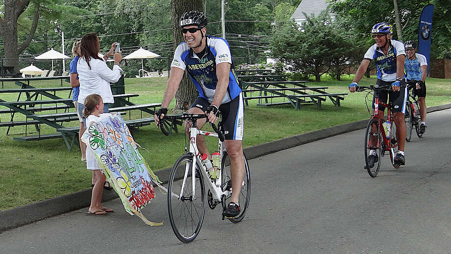 Larry Miller of Swampscott, Mass.; Ron Kramer of Boston, and Mike Brody of Amherst, N.H., cross the finish line of the CT Challenge Bike Ride 80-mile event Friday at the Fairfield County Hunt Club. Photo: Mike Lauterborn / Westport News contributed