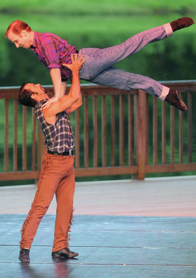 "Marcos Vedoveto hoists Jeremy Cox into the air during the dance routine ""Boys Will Be Cowboys"" at Connecticut Ballet's Summer Dance Caravan Tour performance, ""Fabulous Duets for a Summer Evening,"" at Ives Concert Park in Danbury, Conn. on Friday, July 26, 2013. Photo: Tyler Sizemore / The News-Times"