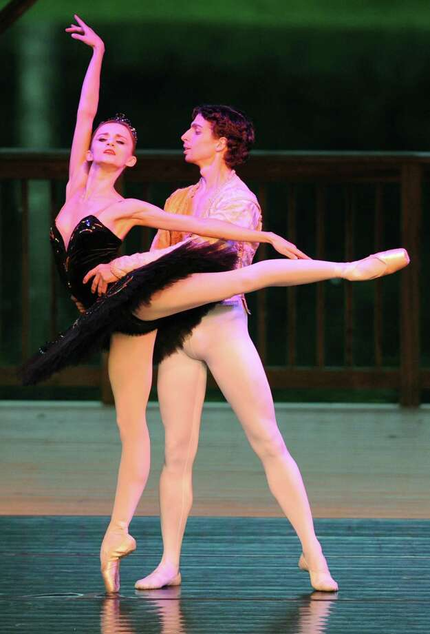"""Oksana Maslova and Anton Kandourov dance during the dance routine """"Black Swan"""" at Connecticut Ballet's Summer Dance Caravan Tour performance, """"Fabulous Duets for a Summer Evening,"""" at Ives Concert Park in Danbury, Conn. on Friday, July 26, 2013. Photo: Tyler Sizemore / The News-Times"""