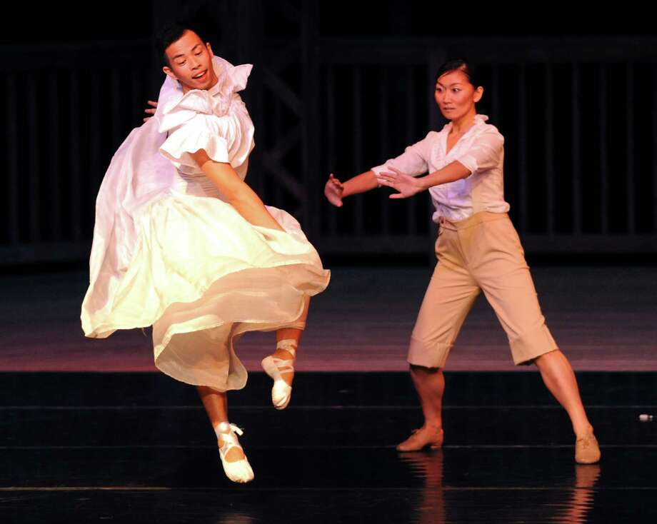 """Kei Tsuruharatani, left, and Yuki Imaizumi dance during the dance routine """"Seek, Seek and Ye Shall Find!"""" at Connecticut Ballet's Summer Dance Caravan Tour performance, """"Fabulous Duets for a Summer Evening,"""" at Ives Concert Park in Danbury, Conn. on Friday, July 26, 2013. Photo: Tyler Sizemore / The News-Times"""