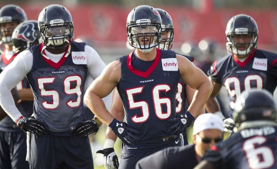 Houston Texans linebackers Whitney Mercilus (59) and Brian Cushing (56) get ready to run a drill during Texans training camp at the Methodist Training Center Friday, July 26, 2013, in Houston. Photo: Brett Coomer, Houston Chronicle