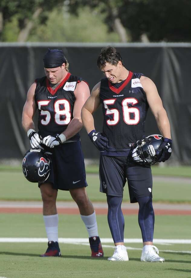 Houston Texans Brooks Reed (58) and Brian Cushing (56) talk on the sidelines during NFL football training camp Friday, July 26, 2013, in Houston. Photo: Pat Sullivan, Associated Press