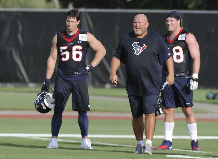 Houston Texans linebackers coach Reggie Herring, center, watches work outs with Brian Cushing (56) and Brooks Reed during NFL football training camp Friday, July 26, 2013, in Houston. Photo: Pat Sullivan, Associated Press