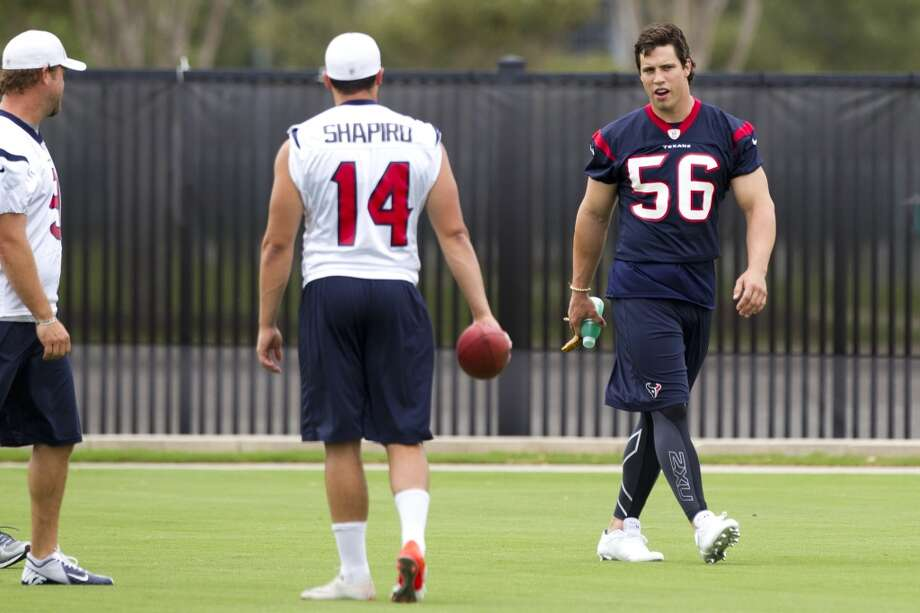 Houston Texans linebacker Brian Cushing (56) walks past punters Shane Lechler, left, and Andrew Shapiro (14) as he walks onto the practice field during Texans' Organized Team Activities at the Methodist Training Center Thursday, May 23, 2013, in Houston. Photo: Brett Coomer, Houston Chronicle