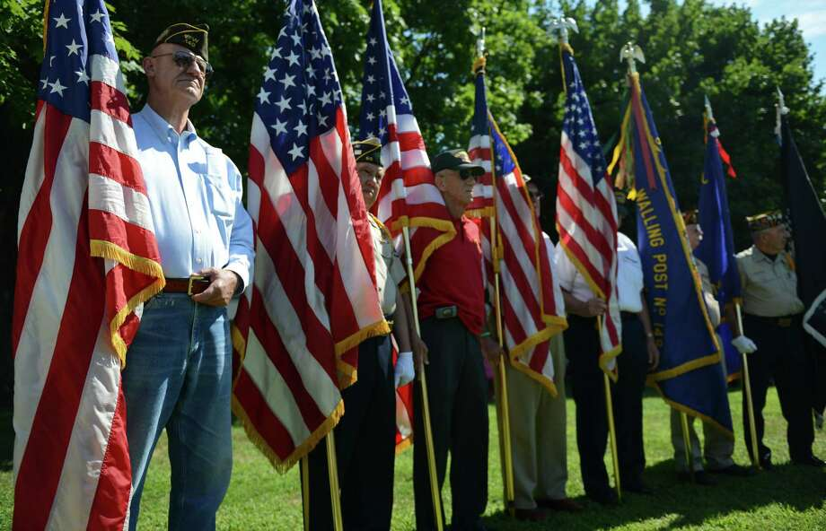 Members of the honor guard watch the Korean War Memorial Ceremony at Rogers Park in Danbury, Conn. on Saturday, July 27, 2013.  The ceremony celebrated the 60th anniversary of the armistace, thanking those who fought and remembering those who died during the Korean War. Photo: Tyler Sizemore / The News-Times