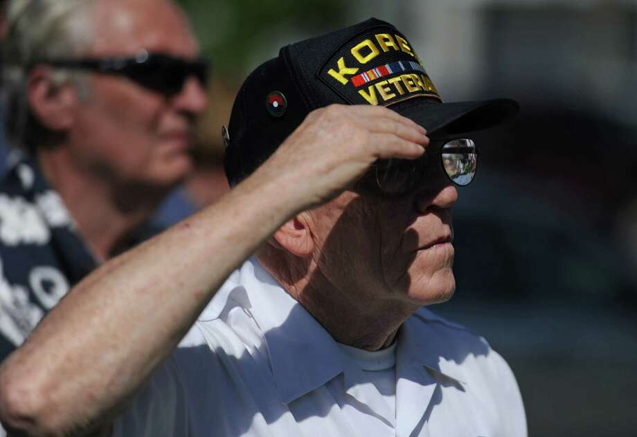 Stanley Britton, who served in the Korean War from 1949 to 1953, salutes during the Korean War Memorial Ceremony at Rogers Park in Danbury, Conn. on Saturday, July 27, 2013.  The ceremony celebrated the 60th anniversary of the armistace, thanking those who fought and remembering those who died during the Korean War. Photo: Tyler Sizemore / The News-Times
