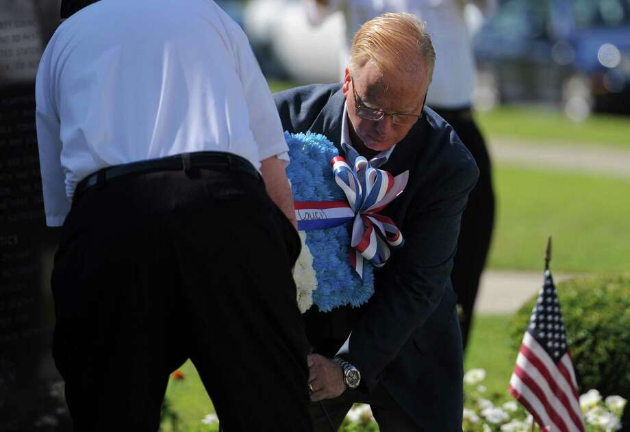 Danbury Mayor Mark Boughton places a wreath in front of the Korean monument during the Korean War Memorial Ceremony at Rogers Park in Danbury, Conn. on Saturday, July 27, 2013.  The ceremony celebrated the 60th anniversary of the armistace, thanking those who fought and remembering those who died during the Korean War. Photo: Tyler Sizemore / The News-Times