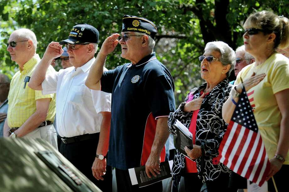 Korean War veterans Pat Vallee, commander of Melvin Rose Legion Post 1231, center, and James Scorsone of Troy, second from left, salute as the National Anthem plays during a ceremony on Saturday, July 27, 2013, at the state Korean War Memorial in Albany, N.Y. The event commemorates the 60th anniversary of the cease fire that ended the Korean War. (Cindy Schultz / Times Union) Photo: Cindy Schultz / 00023306A