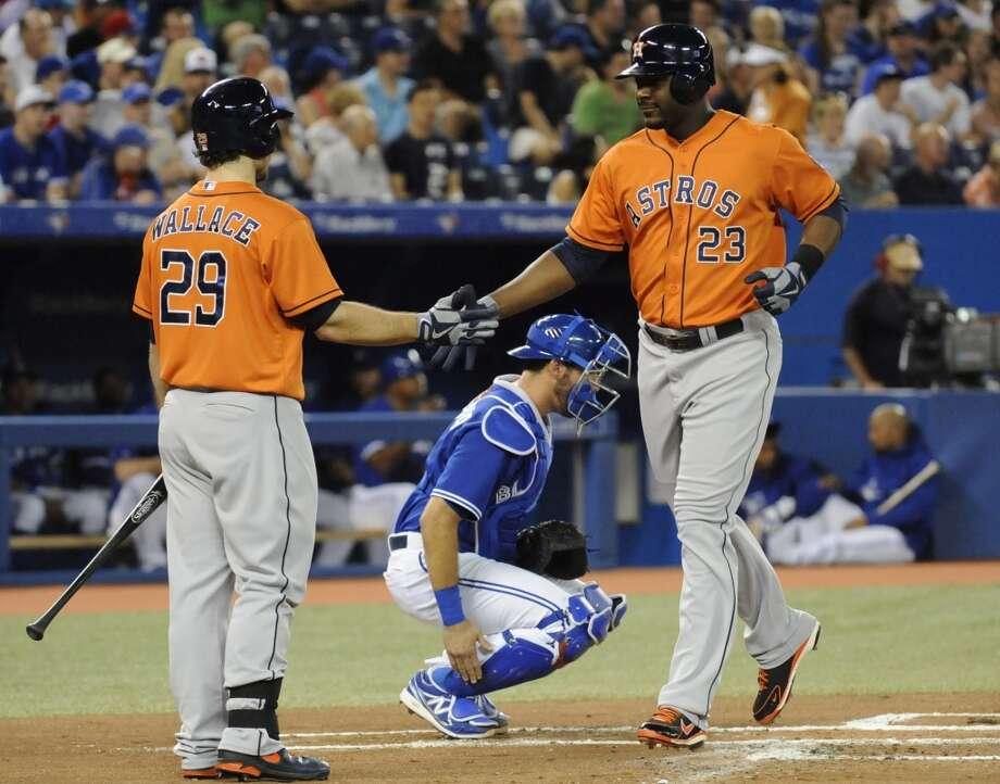 Chris Carter of the Astros is congratulated after hitting a home run. Photo: Jon Blacker, Associated Press/Canadian Press