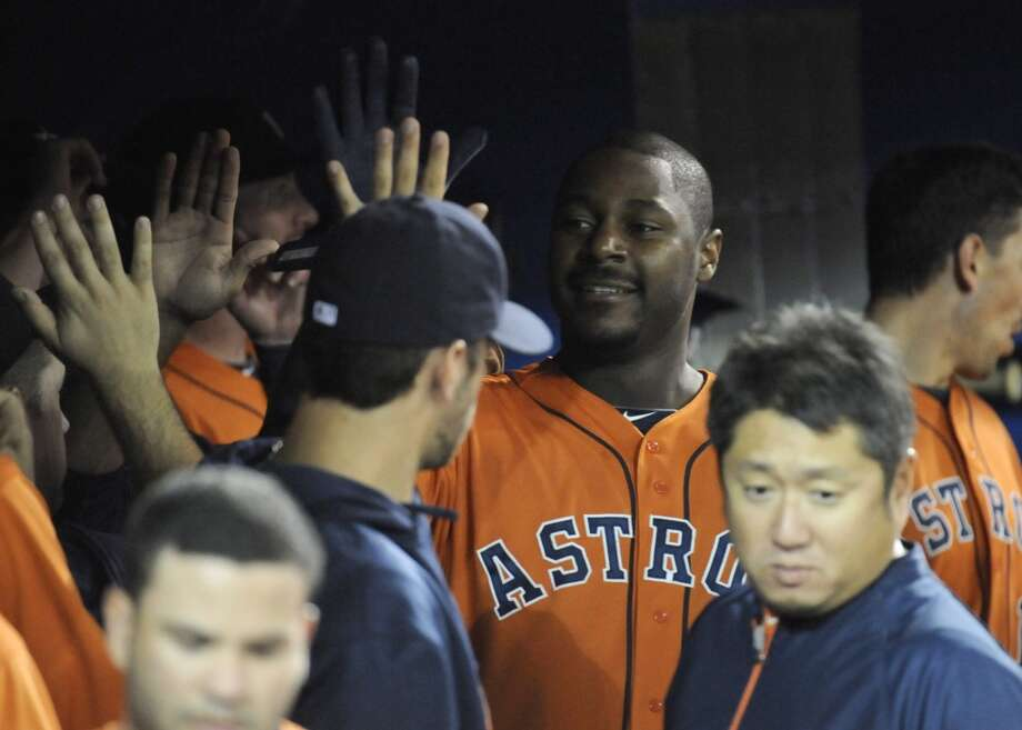 Chris Carter of the Astros is congratulated in the dugout after hitting a home run. Photo: Jon Blacker, Associated Press/Canadian Press