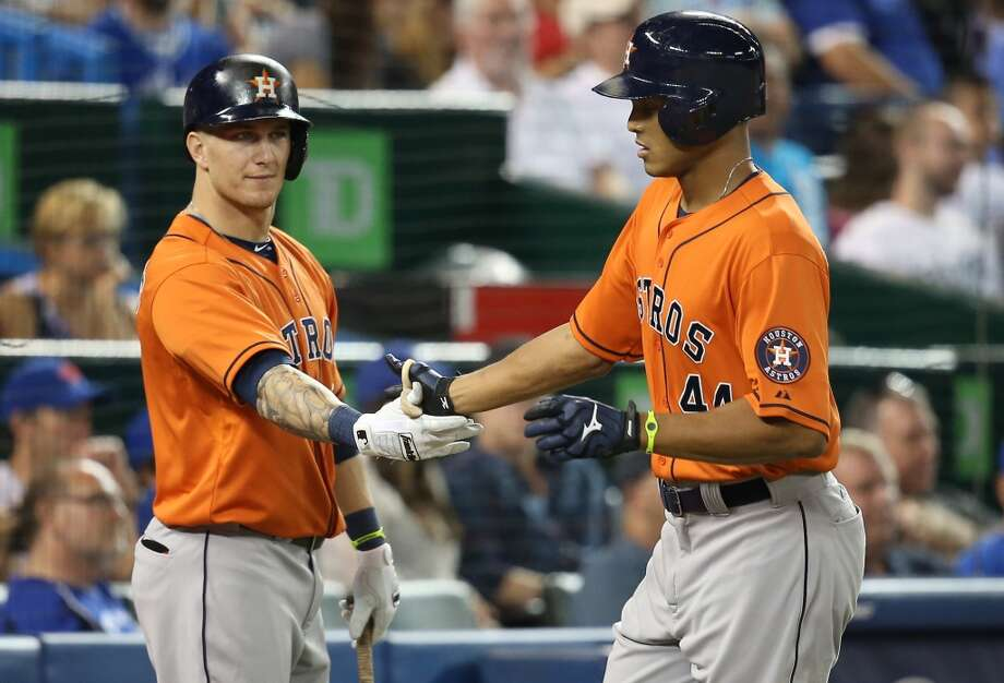 Justin Maxwell of the Astros is congratulated by teammate Brandon Barnes after a solo home run in the fourth inning. Photo: Tom Szczerbowski, Getty Images