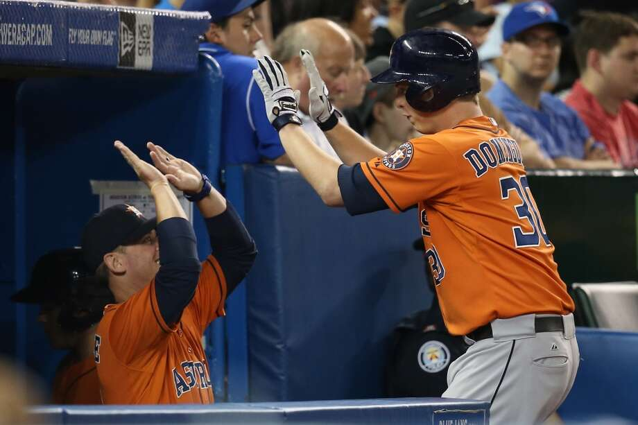 Astros third baseman Matt Dominguez is congratulated in the dugout after hitting a home run. Photo: Tom Szczerbowski, Getty Images