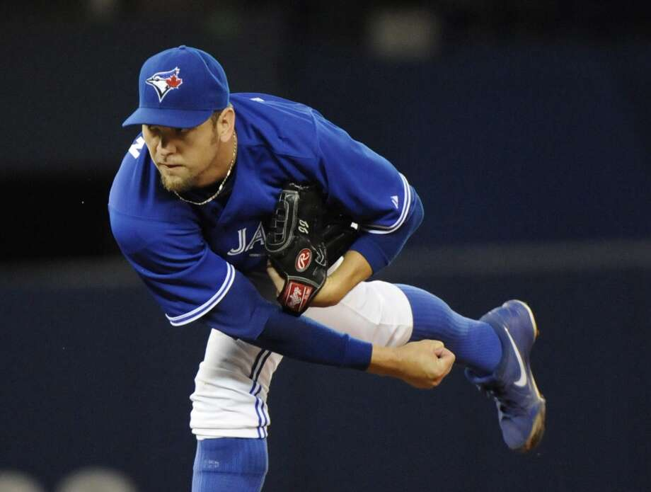 Blue Jays pitcher Josh Johnson makes a throw to the Astros. Photo: Jon Blacker, Associated Press/Canadian Press