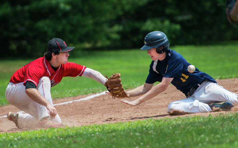 Fairfield third baseman John Carroll doesn't get the ball in time to tag Danbury's Cooper Yusko out so Yusko slides safely into third base during a Connecticut Junior Legion sectional baseball game played at Owen Fish Park, Fairfield, CT on Saturday July 27th, 2013. Photo: Mark Conrad / Connecticut Post Freelance