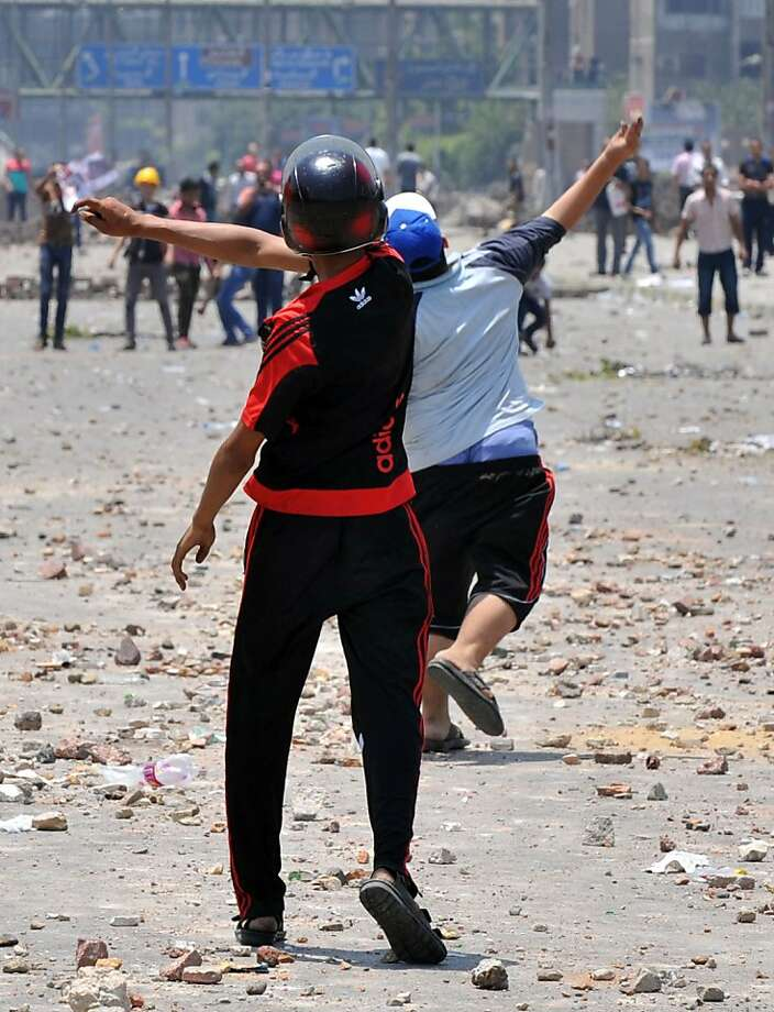 Supporters of the Muslim Brotherhood and Egypt's ousted president Mohammed Morsi battle opponents in Cairo. At least 65 people were killed and dozens hurt in the violence. Photo: Fayez Nureldine, AFP/Getty Images