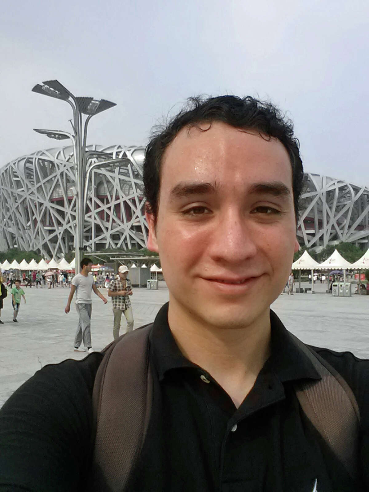 Andres Parrado in front of the Olympic swimming center in Beijing. A Princeton student who went through the ELL program at Westhill, Parrado says students must be engaged to improve the program.