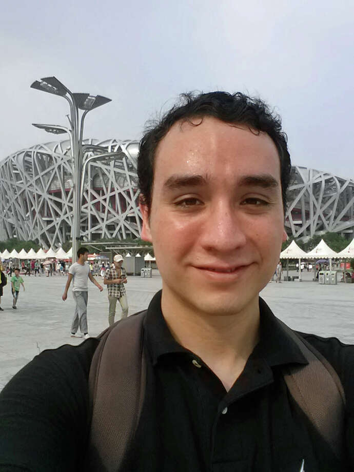 Andres Parrado in front of the Olympic swimming center in Beijing. A Princeton student who went through the ELL program at Westhill, Parrado says students must be engaged to improve the program. Photo: Contributed Photo