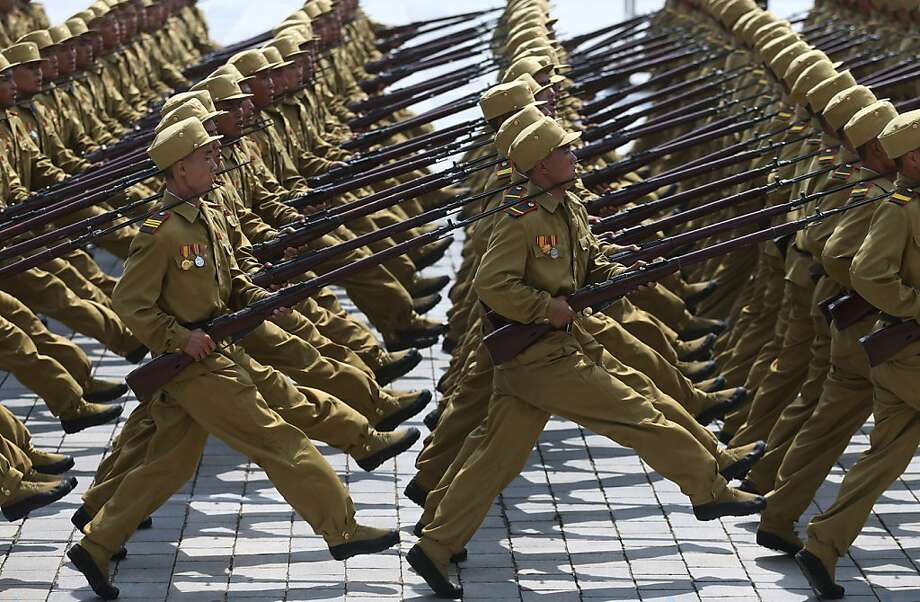 North Korean soldiers march in a parade to mark the 60th anniversary of the end of the Korean War. Leader Kim Jong-Un presided over the nation's largest display of troops and weapons. Photo: Wong Maye-E, Associated Press