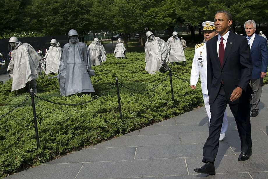 US President Barack Obama walks alongside US Secretary of Defense Chuck Hagel (R) and Korean General Jung Seung-jo (L), Chairman of Korea's Joint Chiefs of Staff, prior to laying a wreath at the Korean War Veterans Memorial to commemorate the 60th anniversary of the signing of the Armistice that ended the Korean War, during a ceremony in Washington, DC, July 27, 2013. AFP PHOTO / Saul LOEBSAUL LOEB/AFP/Getty Images Photo: Saul Loeb, AFP/Getty Images