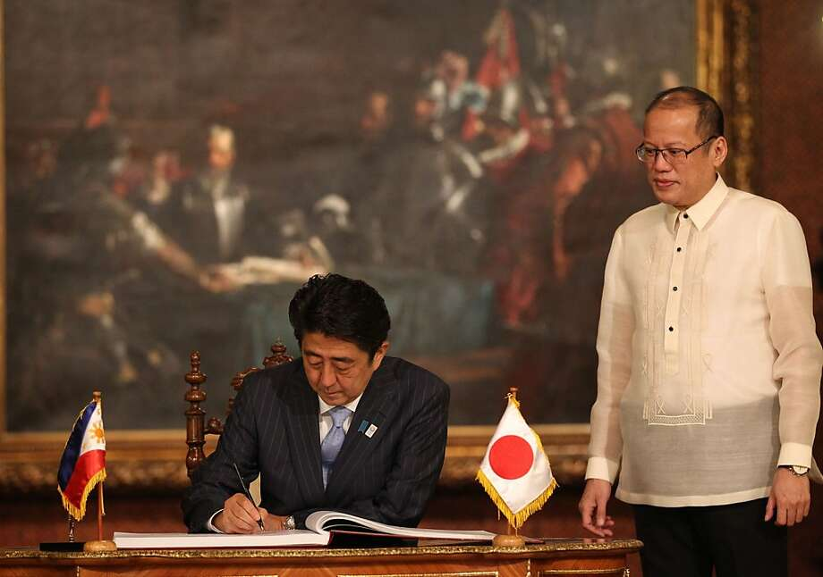 "This handout photo taken on July 27, 2013 and released by Malacanang Photo Bureau (MPB) shows Philippine President Benigno Aquino (R) looking at Japanese Prime Minister Shinzo Abe signing the guest book prior to their meeting at Malacanang Palace in Manila. Abe pledged increased maritime cooperation with the Philippines on July 27, amid growing territorial disputes with regional rival China     AFP PHOTO/ RYAN LIM/MPB                      ----  RESTRICTED TO EDITORIAL USE - MANDATORY CREDIT "" AFP PHOTO / RYAN LIM/MPB""     - NO MARKETING NO ADVERTISING CAMPAIGNS - DISTRIBUTED AS A SERVICE TO CLIENTRYAN LIM/AFP/Getty Images Photo: Ryan Lim, AFP/Getty Images"