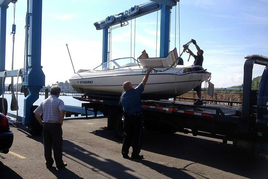 A 21-foot powerboat is removed from the Hudson River. The driver has been charged with vehicular manslaughter after a crash that left one dead, one missing and several hurt. Photo: Frank Becerra Jr, Associated Press
