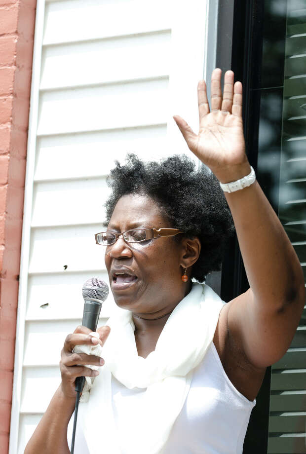 The Rev. Dawn Snell, of Friendship Baptist Church in Stamford prays as the Stamford and Norwalk NAACP Branches Unite for âÄúStop the Violence / We are TrayvonâÄù Rally at the corner of Richmond Hill Avenue and Rose Park Avenue in Stamford on Saturday, July 27, 2013. Photo: Amy Mortensen / Connecticut Post Freelance