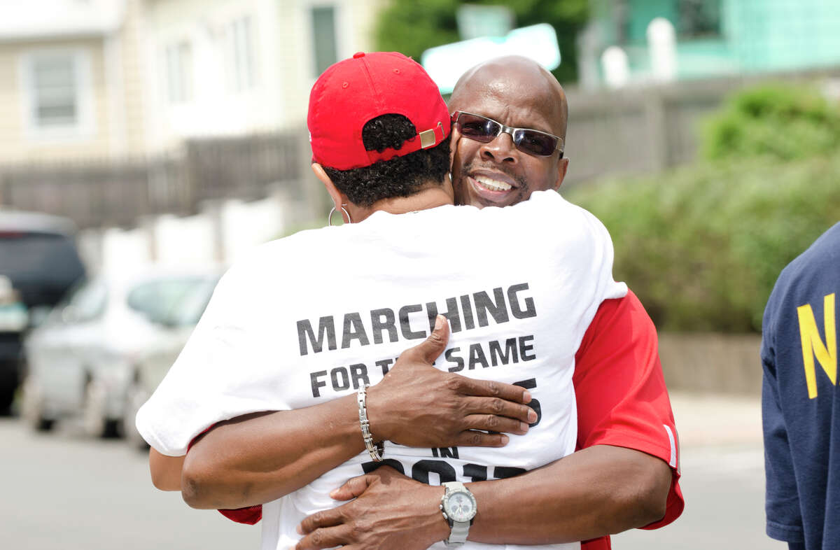 James Jordan, of Stamford, hugs Jere Eaton, of the Community Collective, as the Stamford and Norwalk NAACP Branches Unite for âÄúStop the Violence / We are TrayvonâÄù Rally at the corner of Richmond Hill Avenue and Rose Park Avenue in Stamford on Saturday, July 27, 2013.