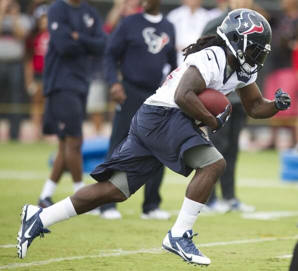 Texans fullback Greg Jones takes a carry during the second day of camp.