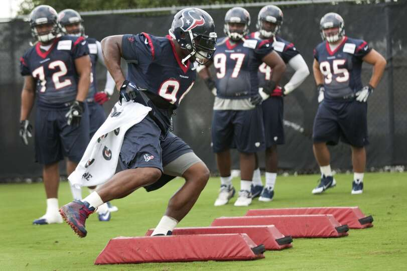 Texans defensive lineman Antonio Smith participates in a drill during training camp.