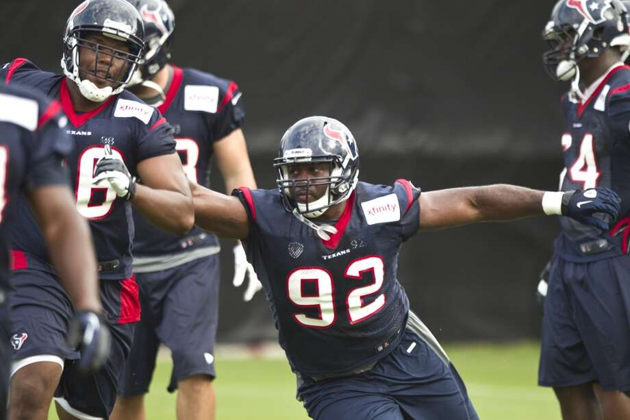 Texans defensive lineman Earl Mitchell participates in a drill during camp. Photo: Brett Coomer, Houston Chronicle