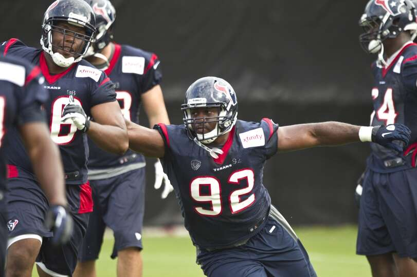 Texans defensive lineman Earl Mitchell participates in a drill during camp.