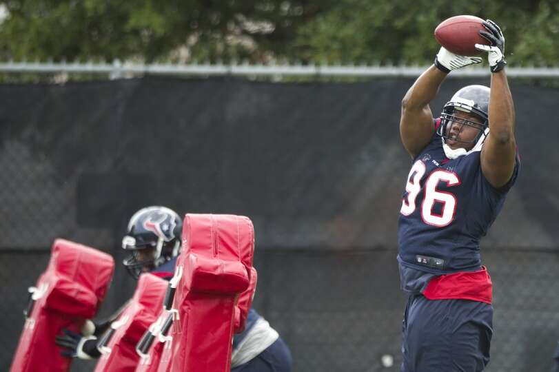 Tim Jamison of the Texans tries to make a catch during training camp.