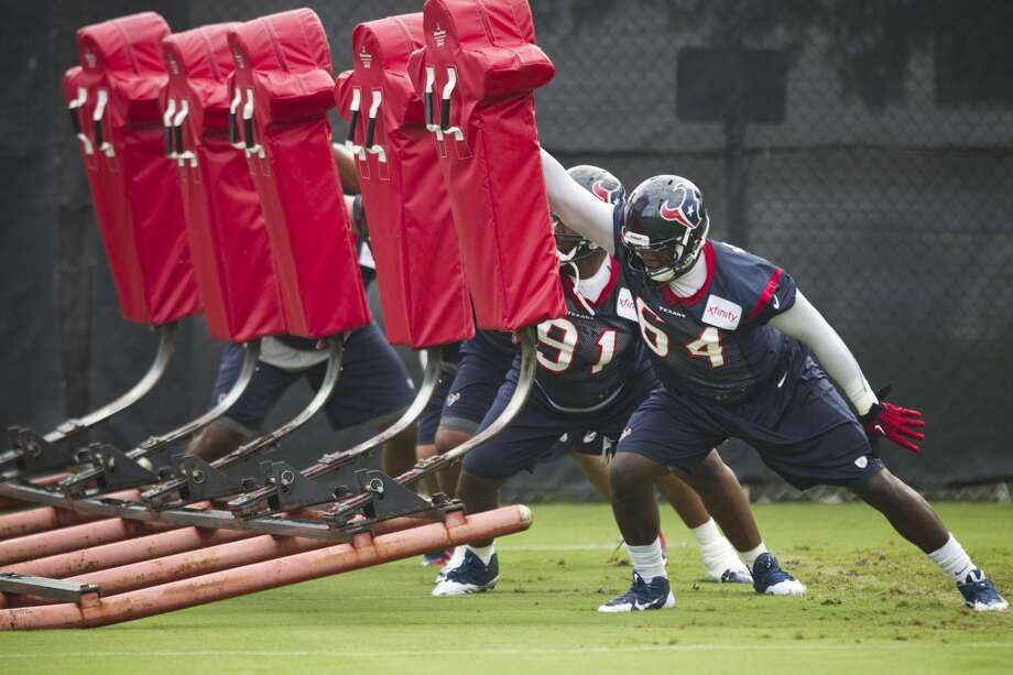 Daniel Muir and Delano Johnson of the Texans participate in drills at training camp. Photo: Brett Coomer, Houston Chronicle