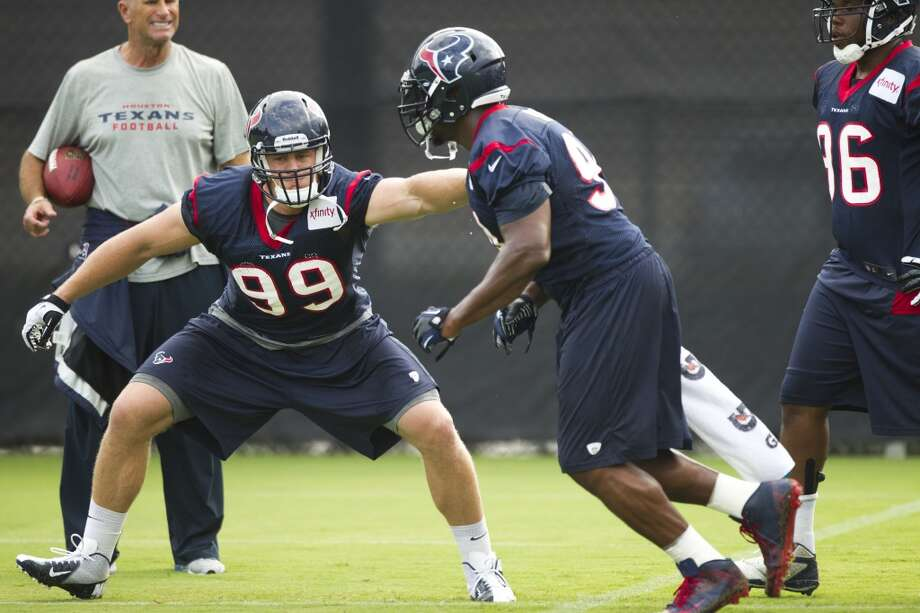 Texans defensive linemen Antonio Smith and J.J. Watt participate in drills during training camp. Photo: Brett Coomer, Houston Chronicle