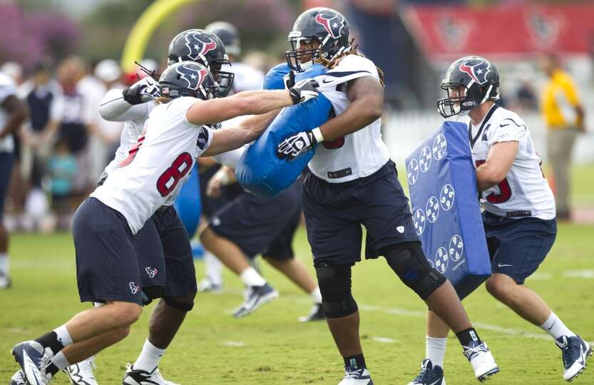Jake Byrne and Brennan Williams of the Texans participate in a blocking drill during day two of camp