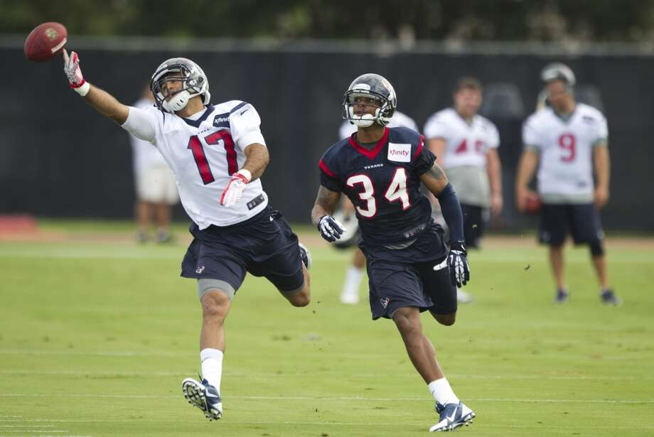 Texans receiver Alec Lemon tries to make a catch during camp. Photo: Brett Coomer, Houston Chronicle