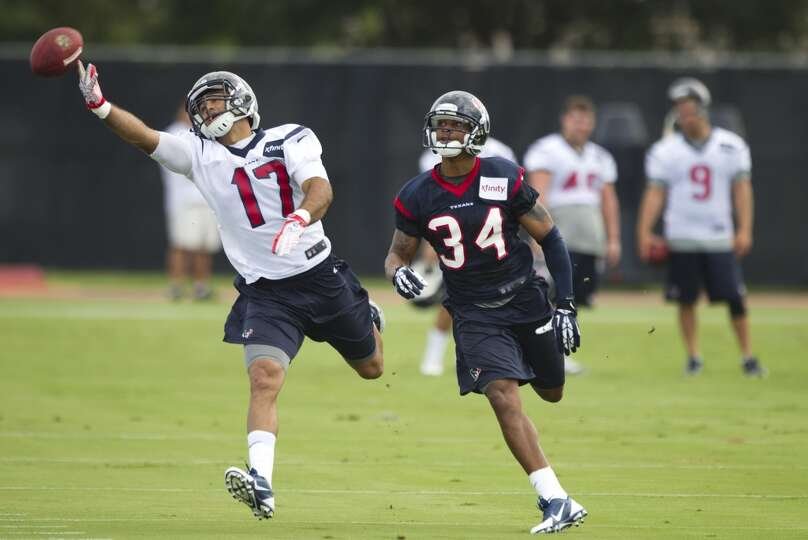 Texans receiver Alec Lemon tries to make a catch during camp.