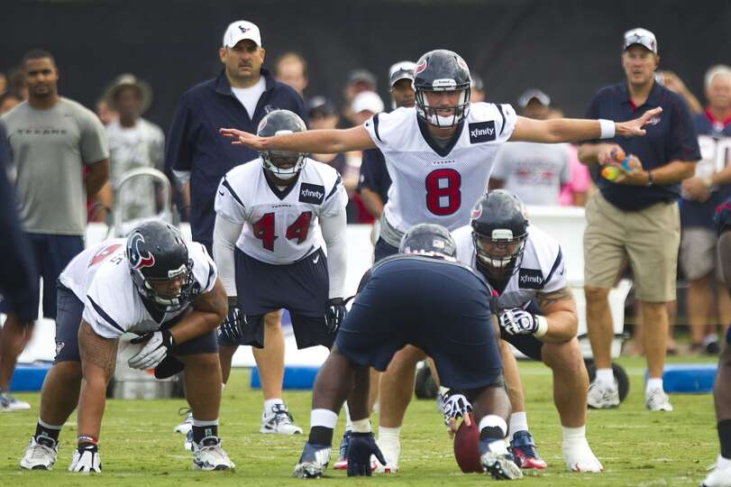Texans quarterback Matt Schaub makes a signal at the line of scrimmage.