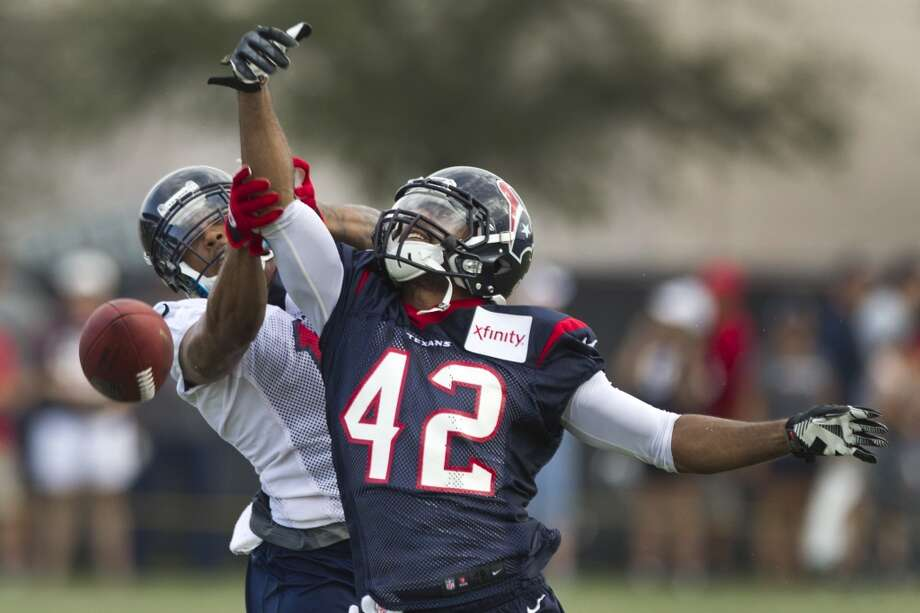 Texans defensive back Johnny Adams breaks up a pass during day two of camp. Photo: Brett Coomer, Houston Chronicle