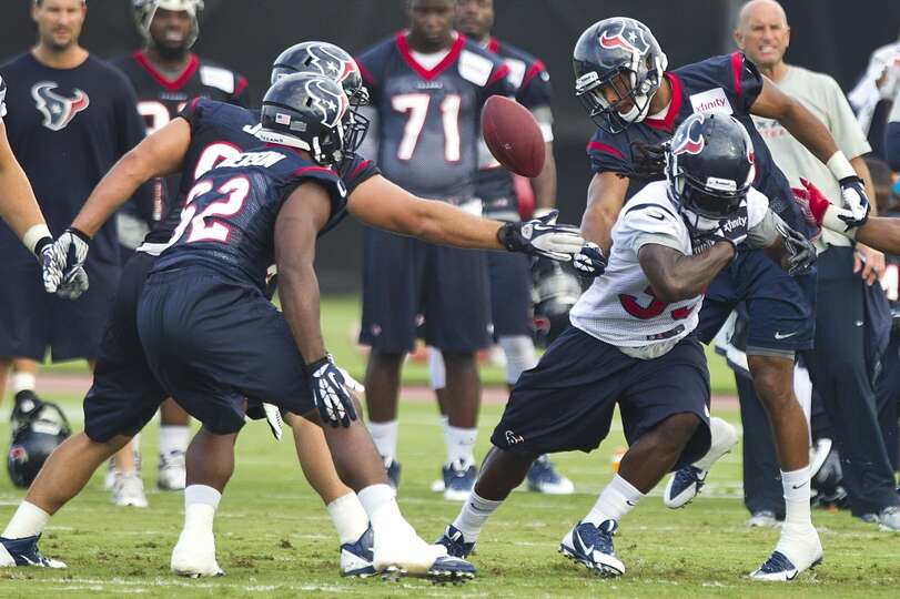 Texans running back Deji Karim loses the handle during training camp.