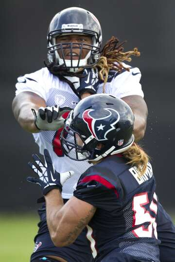 Texans offensive lineman Brennan Williams participates in a drill during camp.
