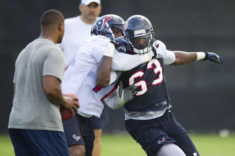 Texans offensive lineman Duane Brown and linebacker Willie Jefferson participate in a drill. Photo: Brett Coomer, Houston Chronicle