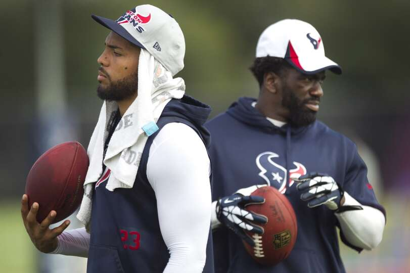 Texans running back Arian Foster and safety Ed Reed are inactive at the start of camp.