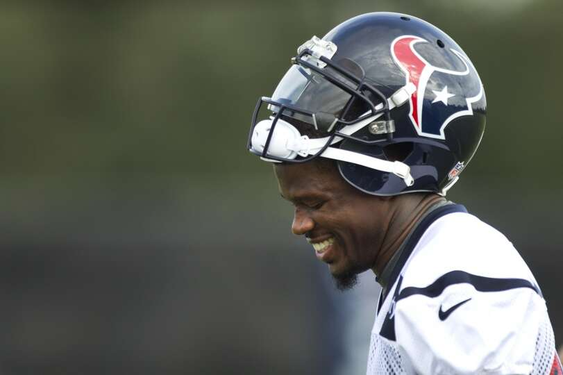 Texans receiver Andre Johnson looks on during training camp.