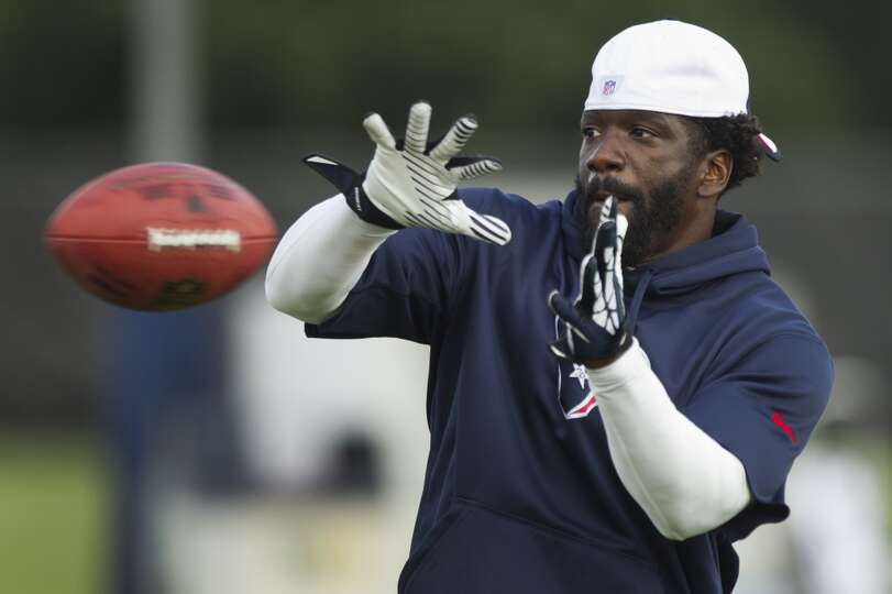 Texans safety Ed Reed looks to make a catch during the second day of camp.